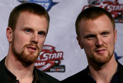 Daniel Sedin and Henrik Sedin of the Vancouver Canucks answer questions before the draft. They predicted they'd probably be split up.