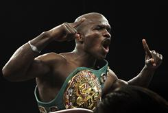 Timothy Bradley celebrates his victory over Devon Alexander during their WBC/WBO World Championship Unification fight in Pontiac, Mich.