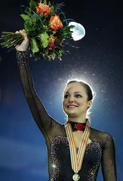Sarah Meier celebrates winning a gold medal at the European Figure Skating Championships in Bern, Switzerland on Saturday.