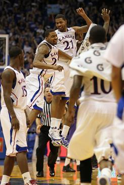 Brothers Marcus Morris (22) and Markieff Morris (21) of the Kansas Jayhawks celebrate during their blowout win over Kansas State.