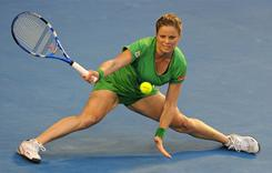 Kim Clijsters of Belgium stretches out for a forehand against Li Na of China in the women's singles final Saturday at the Australian Open in Melbourne.