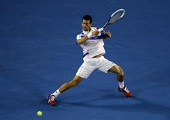 Novak Djokovic of Serbia follows through on a forehand during his 6-4, 6-2, 6-3 victory against Andy Murray of Britain in the Australian Open singles final on Sunday in Melbourne. Djokovic claims his second Australian Open title and second Grand Slam overall.