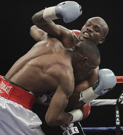 Devon Alexander, foreground, and Timothy Bradley fought st close rangle much of the fight, with head butts eventually causing the fight to be stopped and Bradley won on a technical decision during their junior welterweight unification fight st the Silverdome in Pontiac, Mich.