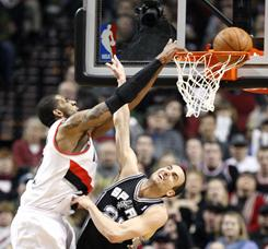LaMarcus Aldridge throws down two of his career-high 40 points in the Blazers' 99-86 win Tuesday over the Spurs.
