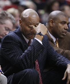 Cavaliers coach Byron Scott rubs his eyes during the fourth quarter of Cleveland's 117-90 loss to the Miami Heat, the team's 21st loss in a row.