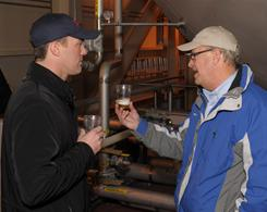 Anheuser-Busch brewmaster George Reisch, right, analyzes a fresh sample with NASCAR driver Kevin Harvick during a tour of the company's St. Louis brewery.