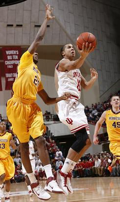 Indiana's Verdell Jones (12) drives against Minnesota's Austin Hollins during their game Wednesday. Jones finished with 12 points in the win.