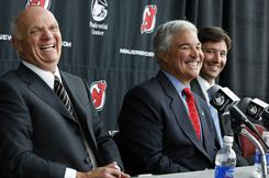 Jeff Vanderbeek, center, sitting next to executive Lou Lamoriello, left, and Ilya Kovalchuk, right, says he has no interest in selling the New Jersey Devils.