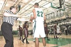 A basketball official hands the ball to Markel Brown last season during the Louisiana Class 4A state playoffs.