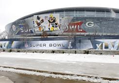 Snow blanketed the area around Cowboys Stadium on Tuesday.