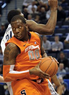 Syracuse's Rick Jackson grabs a rebound against Connecticut in the second half on Wednesday. Jackson finished with a double-double in Syracuse's 66-58 win.