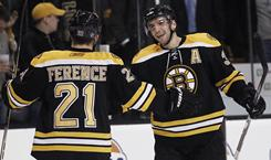 Boston Bruins' Patrice Bergeron, right, and Andrew Ference, left, congratulate one another after one of their six goals against the Stars.