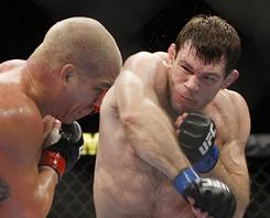 Forrest Griffin, right, swings at Tito Ortiz during their mixed martial arts light heavyweight bout Nov. 21, 2009, in Las Vegas. Griffin won by split decision.