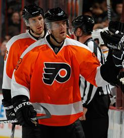Ville Leino notched his first two-goal game of the season to help the Flyers edge the Predators.