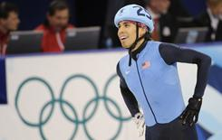 Apolo Anton Ohno celebrates after the men's 5,000-meter relay final at the Vancouver Olympics.
