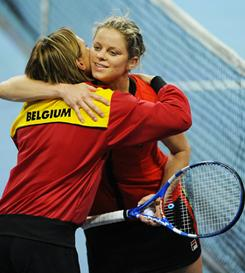 Team captain Sabine Appelmans, left, celebrates with Kim Clijsters after Belgium took a 2-0 lead against the USA on Saturday in Round 1 of Fed Cup in Antwerp. Clijsters defeated Melanie Oudin 6-0, 6-4.