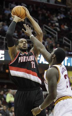 Portland's LaMarcus Aldridge shoots over Cleveland's J.J. Hickson in the first quarter on Saturday. The Cavs lost their 24th consecutive game, an NBA record.