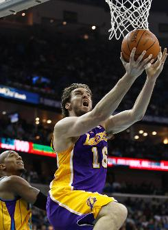 Los Angeles power forward Pau Gasol shoots during the first quarter on Saturday. Gasol finished with 34 points to lead the Lakers over the New Orleans Hornets 101-95.