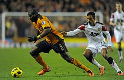 Wolverhampton's George Elokobi, left, vies with Manchester United's Nani, right, during an English Premier League match on Saturday.