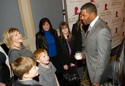 Fox Sports analyst Michael Strahan meets with cancer survivors and their families at a fundraiser for the St. Jude Children's Hospital during Super Bowl week.