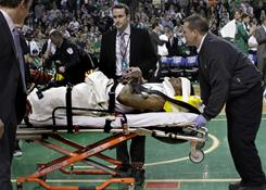 Celtics guard Marquis Daniels is taken off the court on a stretcher after injuring his back in a collision with Magic guard Gilbert Arenas in the second quarter.