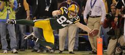 Green Bay Packers wide receiver Jordy Nelson dives for the end zone in the fourth quarter.