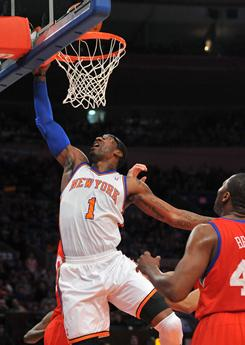 Knicks forward Amare Stoudemire, laying in a shot in front of 76ers forward Elton Brand, right, scored 41 points in the 117-103 win, matching his season-high.
