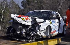 The wrecked car of Poland's Robert Kubica is towed Sunday after he hit a wall at high speed in the Rode de Anora Rally event in Italy.