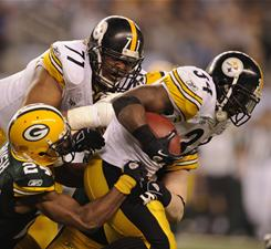 Rashard Mendenhall (34) rushed for 63 yards and a touchdown but had a costly fourth-quarter fumble that led to a Green Bay score.