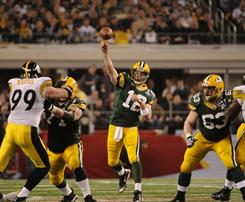 Packers quarterback Aaron Rodgers fires downfield during the fourth quarter.