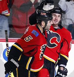 Calgary Flames' Curtis Glencross, right, celebrates his game-winning goal with teammate Mark Giordano in the third period against the Blackhawks.