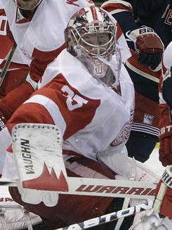 Red Wings goalie Jimmy Howard makes one of his 45 saves against the Rangers to help preserve a 3-2 win for Detroit in Pavel Datsyuk's first game back since December.