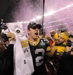 Packers quarterback Aaron Rodgers (12) joins the celebration after beating the Steelers 31-25 in Super Bowl XLV.