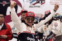 Dale Earnhardt celebrates after winning the 1998 Daytona 500.