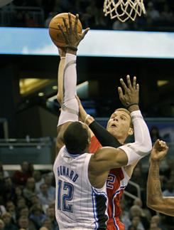Magic center Dwight Howard tangles with the Clippers' Blake Griffin on Tuesday night in Orlando. Howard tallied 22 points and 20 rebounds while Griffin was held to 10 points and 12 rebounds in the Magic's 101-85 victory.