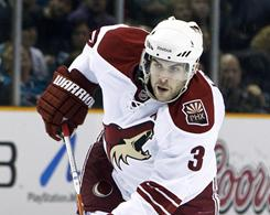 The Coyotes' Keith Yandle, center, the NHL's top-scoring defenseman, admits he was too focused on offense earlier in his career.