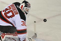 "Martin Brodeur was hurt when something ""popped"" in his right knee during a game Sunday against the Montreal Canadiens."