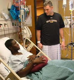 Wake Forest baseball coach Tom Walter, right, visits with player Kevin Jordan one day after donating a kidney to Jordan at Emory University Hospital in Atlanta.