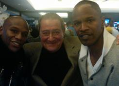 From left, Floyd Mayweather, Bob Arum and Jamie Foxx pose for a photo in Jerry Jones' box at Cowboys Stadium during the Super Bowl last Sunday.