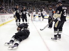 Pittsburgh's Evgeni Malkin, on ice, will have season-ending knee surgery on Thursday.