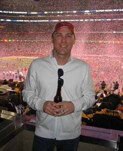 Kevin Harvick enjoys a Budweiser during Sunday's Super Bowl at Cowboys Stadium in Arlington, Texas.