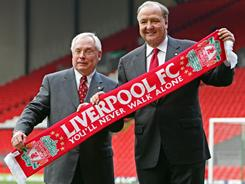George Gillett, left, and Tom Hicks finalized their takeover of Liverpool in March 2007. After being forced to sell the club last October, they're now seeking damages.