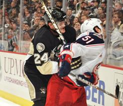 Pittsburgh's Matt Cooke received a four-game suspension for this hit from behind on Columbus' Fedor Tyutin.