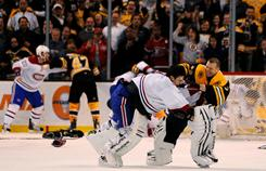 Boston goalie Tim Thomas (right) fights with Montreal goalie Carey Price while Steven Kampfer (47) and James Wisniewski (20) fight in the backgound on Wednesday night.