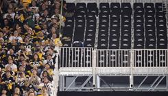 A section of empty seats is seen at Cowboys Stadium before Super Bowl XLV. The seats were deemed unsafe before the game.