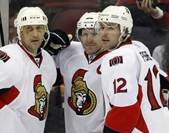 Ottawa's Alexei Kovalev, left, and Mike Fisher, right, could be sought after by other teams leading up to the Feb. 28 trade deadline.