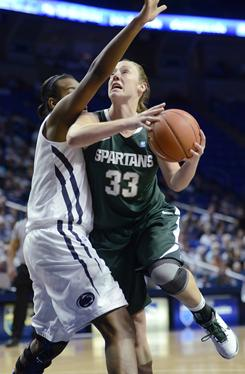 Michigan State's Taylor Alton, right, looks to score past Penn State's Talia East during the second half of their game in State College, Pa.
