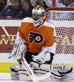 Flyers goalie Brian Boucher makes one of his 31 saves Thursday. He limited the Hurricanes to one goal as Philadelphia padded its Eastern Conference lead.