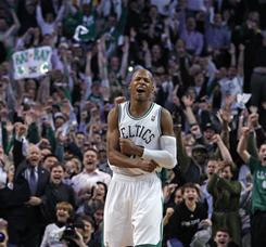 Ray Allen celebrates after making the 2,561st three-pointer of his career, setting an NBA record.