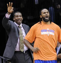 New York's Amare Stoudemire, left, and Ronny Turiaf react during the second quarter on Saturday. Stoudemire has a sprained right big toe and did not play, but the Knicks beat the New Jersey Nets 105-95 nevertheless.